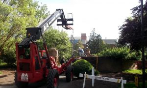 A&A telehandler aligning an historic gate into place at Gwynedd Mercy University in Gwynedd Valley, PA.