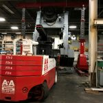Dismantling and removing a press with hydraulic gantires and versa lifts