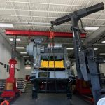 Rigging a press into place with hydraulic gantries