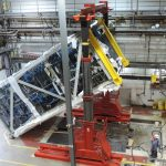 Erecting a pharmaceutical distillation column module within near-zero clearance environment using 300 ton hydraulic gantry system