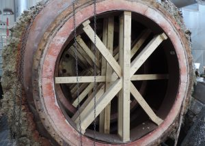 Internal bracing and support of refractory in burner units for removal and transport