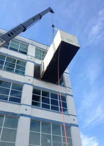 Rigging contents of a container into the 4th floor of a building through a window penetration