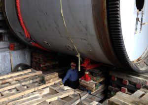 Removal and replacement of 200,000# rotary kiln.  Required plating and cribbing of basement area to jack and slide kiln sideways to remove, and the same process in reverse to install the new rotary kiln