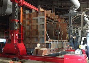 Using 300 ton hydraulic gantry to assemble 550,000# tilting aluminum melt furnace