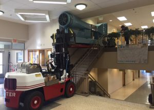 Installing lab-scale wind tunnel equipment into 2nd floor of area technical college