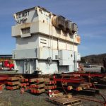 170,000# transformer being loaded from ground to railcar using jacks, slider and unified hydraulic system. Scope included railcar tie-downs and later unloading from railcar to ground at destination site