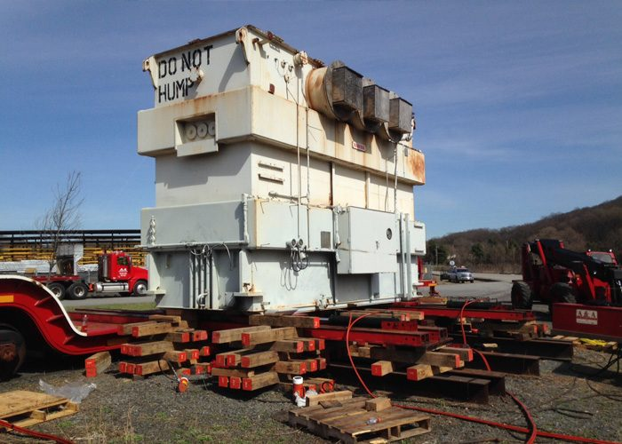 170,000 lb. transformer being loaded from ground to railcar using jacks, slider and unified hydraulic system. Scope included railcar tie-downs and later unloading from railcar to ground at destination site