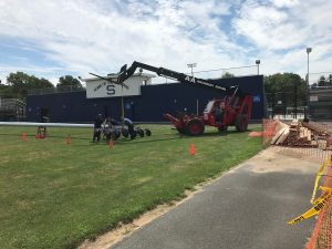 BPI Telehandler assisting in the Installation of new field lights for a local high school.