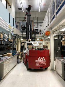 Lifting a 7,500 lb. laboratory granite slab to second floor using 25/35 Versa-Lift
