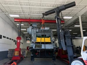 Setting into place a large Verson press with only 6 in. of head room