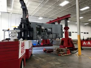 Installation process of a 100,000 lb. press brake with use of a gantry system.