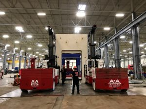 Two 60/80 Versa-Lifts dismantling a Schuler press into sections.