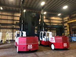 Two 60/80 Versa-Lifts laying down a 98,000 lb. column from a 500 Ton press brake.